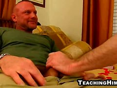 Chad Brock sucking on a mature stud's hard cock