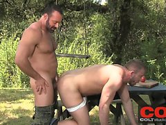Bearded man Brad Kalvo fucks Shay Michaels on a picnic table