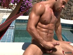 Austin Wilde jerks out a nice big hot load by the poolside