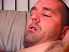 Muscled black stud swallows and straddles a hard white cock on the sofa